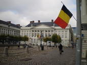 Flag of Belgium flying, Martyrs' Square - Place des Martyrs - Martelaarsplaats, Brussels, Belgium